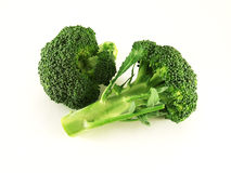 Broccoli. Fresh broccoli isolated over white stock images