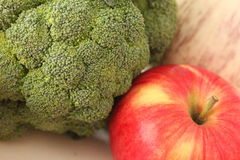 Broccoli and Apple Stock Photo