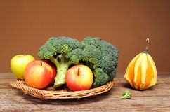 Broccoli, apples and decorative pumpkins Royalty Free Stock Images