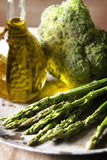 Broccoli, asparagus and olive oil. In a jug Royalty Free Stock Photography