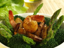 Broccoli, asparagus and shrimps Royalty Free Stock Photos