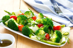 Broccoli with Asparagus and Zucchini salad Stock Photos