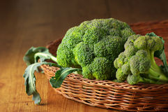 Broccoli in basket Stock Photos
