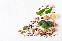 Broccoli, beans and nuts - vegan sources of vegetable protein stock images