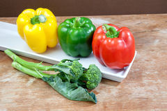 Broccoli and bell pepper fresh yellow red and green Stock Photos