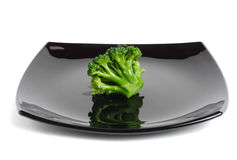 Broccoli on a black dish Stock Photos
