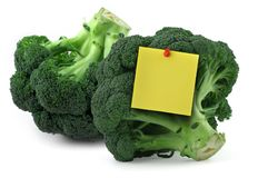 Broccoli with blank yellow note Royalty Free Stock Images