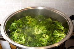 Broccoli at boiling. Some broccoli in a bole with water at boiling Stock Images