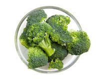 Broccoli in bowl from above. Broccoli in glass bowl on a white background seen from above Stock Photography