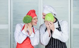 Broccoli and cabbage. Chef prepares meal. man and woman chef in restaurant. vegetarian. cook Family cooking in kitchen. Broccoli and cabbage. Chef prepares meal royalty free stock images