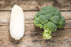 Broccoli and Cabbage on grunge wooden board. Top View Royalty Free Stock Image