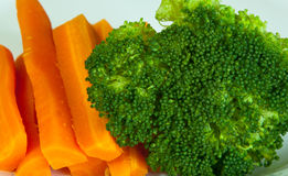 Broccoli and carrot. On the dish Stock Images