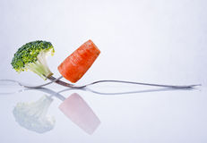 Broccoli and carrot composition Royalty Free Stock Photo