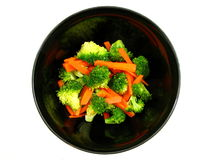 Broccoli and Carrots. Isolated photo of lightly steamed broccoli and carrots in a black bowl Stock Images