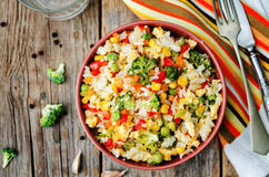 Broccoli carrots corn green peas red pepper rice Royalty Free Stock Photo