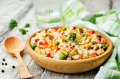Broccoli carrots corn green peas red pepper rice Royalty Free Stock Image