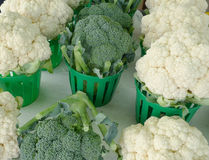 Broccoli and cauliflower. Baskets of broccoli and cauliflower at the market Royalty Free Stock Photos