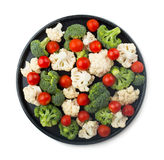 Broccoli, cauliflower and cherry tomatoes. Fresh ripe organic broccoli, cauliflower and cherry tomatoes on dish  isolated on white background Royalty Free Stock Photography