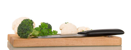 Broccoli, cauliflower, parsley, wooden board and knife isolated on white. Royalty Free Stock Photo
