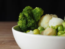 Broccoli. Cauliflower peas green in plate Royalty Free Stock Photography
