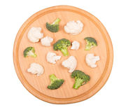 Broccoli and cauliflower, round wooden board isolated on white. Stock Photo
