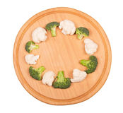 Broccoli, cauliflower and  round wooden board isolated on white background. Stock Photos