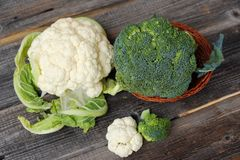 Broccoli and cauliflower on a wooden table royalty free stock images