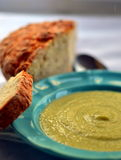 Broccoli and celery cream soup. Vegan cream soup made from broccoli, celery stalks, fresh lemon juice served with fresh irish soda bread stock images