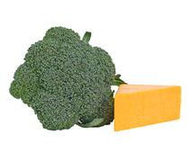 Broccoli and cheese. Broccoli and cheddar cheese on white background royalty free stock image