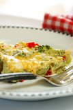 Broccoli Cheese Egg Frittata. Plate of broccoli cheese frittata with red peppers Stock Images