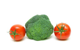 Broccoli and cherry tomatoes isolated on a white background clos Royalty Free Stock Images