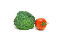 Broccoli and cherry tomatoes on a white background close-up Stock Images
