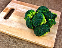 Broccoli on a chopping board Royalty Free Stock Photography
