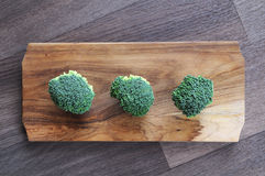 Broccoli, chopping board. Broccoli on wooden chopping board. Indoor photography royalty free stock photography