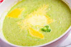 Broccoli cream soup with cheese in white bowl. Close up stock images