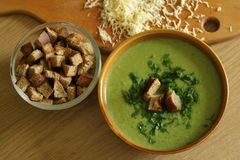 Broccoli cream soup. With croutons and cheese stock photos