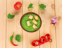 Broccoli cream soup on table. Stock Images