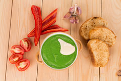 Broccoli cream soup on table. Stock Image