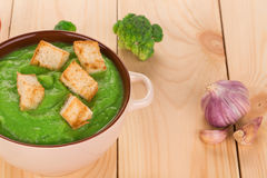 Broccoli cream soup on table. Royalty Free Stock Image