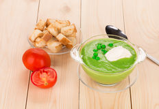 Broccoli cream soup on table. Royalty Free Stock Images