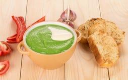 Broccoli cream soup on table. Royalty Free Stock Photos