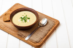 Broccoli cream soup on white wooden table. Broccoli cream soup on the white wooden table royalty free stock images