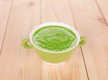Broccoli cream soup on wood. Stock Photos