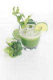 Broccoli ,cucmber , lime and mint juice. Broccoli,cucumber , lime and mint fresh juice in white background vertical stock image
