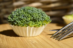 Broccoli cupcake. Raw broccoli stylized as cupcake Stock Photos