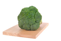 Broccoli on cutting board Stock Image
