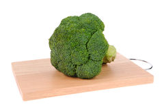 Broccoli on cutting board isolated on white Stock Images