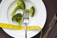 Broccoli diet meal. Fresh broccoli on dish with measure tape in diet meal concept Royalty Free Stock Photography