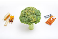 Broccoli and drugs Royalty Free Stock Image