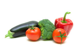 Broccoli, eggplant, cherry tomatoes and red pepper on white back. Broccoli, eggplant, cherry tomatoes and red pepper  on white background close-up. horizontal Royalty Free Stock Photography
